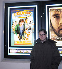 Hackett poses in front of the movie poster in eager anticipation. [Photo by Ted Whalen]